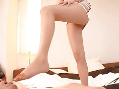 With a pair of smoking hot legs like that what man wouldn't want to be at her feet. Akiho is a 29 yo Japanese beauty that has a feet fetish. She likes dressing on a pantyhose and rubs cock with her feet. She puts some pressure on that dick and looks at it with pleasure. will she get some jizz on her thighs?