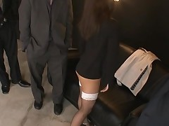 Raunchy hotty in black dress stands on knees and sucks penis