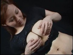 Oriental babe with lactating tits squeezes and squirts