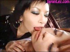 Asian Dominatrix Biting and Pinching Slave
