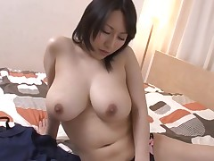 Cute Japanese darling mesmerizes with lusty titty fucking